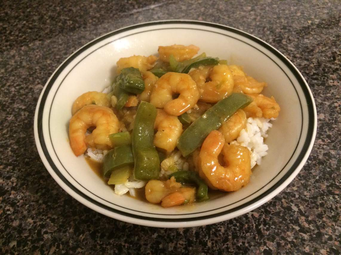 Shrimp Etouffee over rice in a bowl