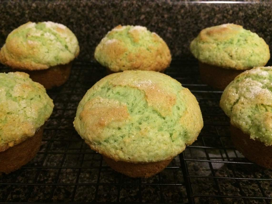Pistachio muffins on a cooling rack