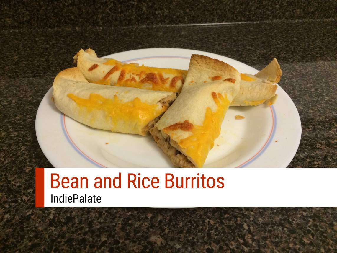 bean and rice burritos on a plate